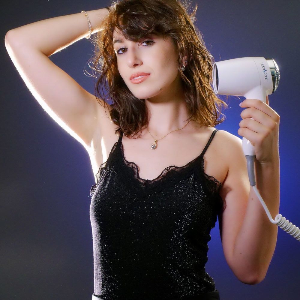 girl with wall mounted hair dryer for hotels